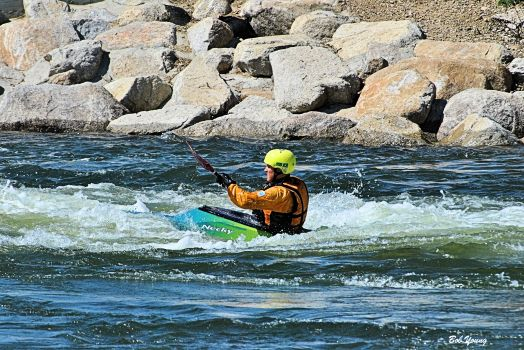 Kayaker enjoying the higher water level on the Boise River. They are also filling the irrigation canals.